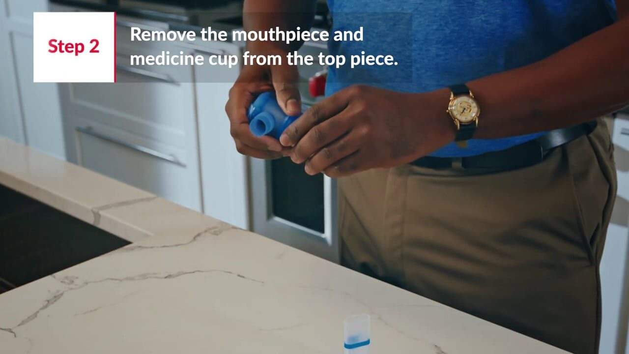 Step2 - Remove the mouthpiece and medicine cup from the top